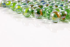 Colorful marbles on white background Stock Photo