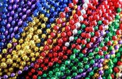 Colorful Mardi Gras Beads. Pile of Mardi Gras Beads ready to be tossed to parade audiences stock photos