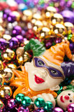 Colorful Mardi Gras Beads and Jester. Vertical of a heap of multi-colored beads with a Jester in bottom right corner. Copyspace background above him stock photography