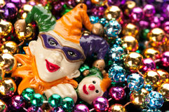Colorful Mardi Gras Beads and Jester. Horizontal of a heap of multi-colored beads with a Jester on left side. Copyspace background on the right royalty free stock image