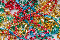 Colorful Mardi Gras Beads. Stringed colorful beads used for holiday celebrations such as Mardi Gras and New Year's royalty free stock photos