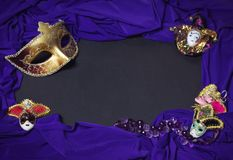 Colorful Mardi Gras or Carnival masks as frame on blackboard. Stock Photos