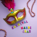 Colorful mardi gras or carnivale mask on a purple background. Venetian masks. top view. Colorful mardi gras or carnivale mask on a purple background. Venetian stock photography
