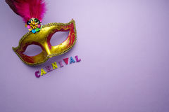 Colorful mardi gras or carnivale mask on a purple background. Venetian masks. top view. Colorful mardi gras or carnivale mask on a purple background. Venetian stock photo