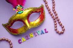 Colorful mardi gras or carnivale mask on a purple background. Venetian masks. top view. Colorful mardi gras or carnivale mask on a purple background. Venetian royalty free stock images