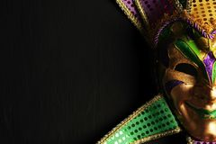 Colorful Mardi Gras mask background. Colorful Mardi Gras jester mask background stock photo