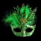 Colorful Mardi Gras mask isolated on black. Colorful green Mardi Gras mask isolated on black stock images