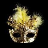 Colorful Mardi Gras mask isolated on black. Colorful gold Mardi Gras mask isolated on black stock photos