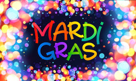 Colorful Mardi Gras sign on dark blue background with shining bokeh lights frame Royalty Free Stock Photography