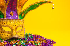 Colorful Mardi Gras or venetian mask on yellow Stock Photo