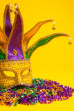 Colorful Mardi Gras or venetian mask on yellow Royalty Free Stock Photo