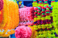 Colorful marigold flower garlands for hindu religious ceremony. Garland of indians for worship goddess in the florist shop nearby Sri Maha Mariamman Temple Stock Photography