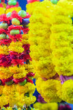 Colorful marigold flower garlands for hindu religious ceremony. Garland of indians for worship goddess in the florist shop nearby Sri Maha Mariamman Temple Stock Image