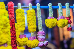 Colorful marigold flower garlands for hindu religious ceremony. Garland of indians for worship goddess in the florist shop nearby Sri Maha Mariamman Temple Royalty Free Stock Images