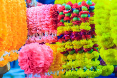 Colorful marigold flower garlands for hindu religious ceremony. Garland of indians for worship goddess in the florist shop nearby Sri Maha Mariamman Temple Royalty Free Stock Photo