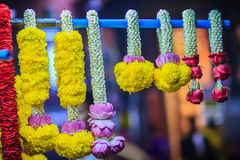Colorful marigold flower garlands for hindu religious ceremony. Garland of indians for worship goddess in the florist shop nearby Sri Maha Mariamman Temple Royalty Free Stock Photography