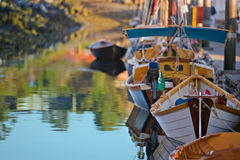 Colorful marina filled with wooden boats royalty free stock photo