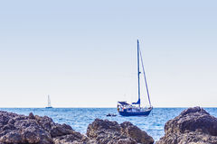 Colorful marine landscape with sail boat against deep blue sea u Stock Photos