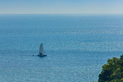 Colorful marine landscape with sail boat against deep blue sea Stock Images
