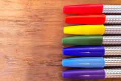 Colorful Marker Pens in Rainbow Order on Wooden Table Royalty Free Stock Photo