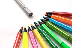 Colorful markers. Arranged in curved marker,Colorful contrast with the gray stock photo