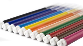 Colorful markers (felt-tip pens) over white Stock Images