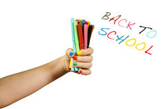 Colorful markers in hand. Isolated on white Stock Image