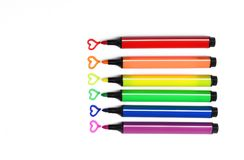 Colorful markers pens with hearts. Colorful markers pen on white backgrounds with hearts royalty free stock photography