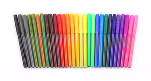 Colorful markers in a row Royalty Free Stock Photos