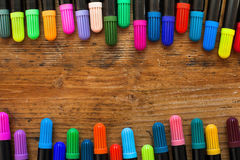 Colorful markers. On wooden desk, background Stock Images