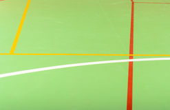Colorful markings on a green indoor court Stock Image
