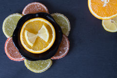 Colorful marmalade lemon and orange pieces with sugar and sliced Stock Photo