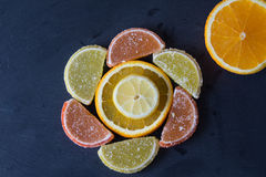 Colorful marmalade lemon and orange pieces with sugar and sliced Royalty Free Stock Photos