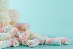 Colorful marshmallow heap on aquamarine background Royalty Free Stock Images