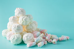 Colorful marshmallow heap on aquamarine background Royalty Free Stock Photo