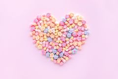 Colorful marshmallow in heart shape.Party and celebration.decorative background texture. Flat lay royalty free stock images