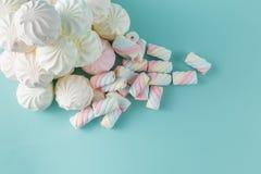 Colorful marshmallow hill on aquamarine background Stock Photos