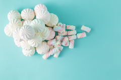 Colorful marshmallow hill on aquamarine background Royalty Free Stock Photo
