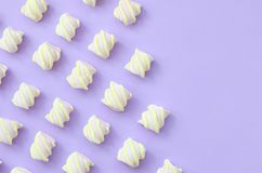 Colorful marshmallow laid out on violet paper background. pastel creative textures with copy space. minimal.  royalty free stock photos