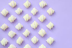 Colorful marshmallow laid out on violet paper background. pastel creative textures with copy space. minimal.  royalty free stock photography