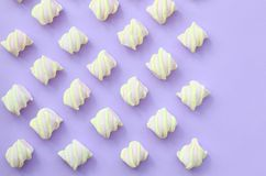 Colorful marshmallow laid out on violet paper background. pastel creative textures with copy space. minimal.  royalty free stock photo