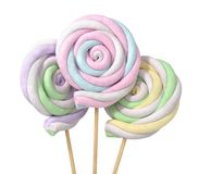 Colorful marshmallows in form of spiral on the sticks. Royalty Free Stock Images