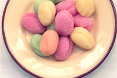 Colorful marshmallows on pastel yellow plate Stock Photo