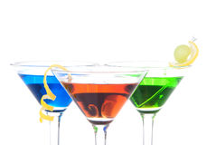 Colorful Martini Cocktails blue green and red. Colorful Martini Cocktails drink blue green and red on top composition with vodka, light rum, gin, tequila, blue Stock Photo