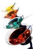 Colorful martinis. A row of colorful martinis on white Royalty Free Stock Photo