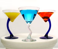 Colorful martinis. Three curved glasses of colorful martinis shoot in a studio Stock Photography