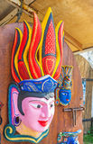 The colorful mask. The colorful wooden mask decorates the door of craftsman store, Galle, Sri Lanka Royalty Free Stock Photo