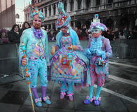 Colorful Masquerade of Venice Carnival. Venice, Italy - 27 February, 2009:  residents of Venice wearing costumes and masks during most significant festival of Royalty Free Stock Photography