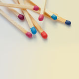 Colorful matches closeup. Wooden multicolored matches. Retro colors background. Macro view, toned photo stock images