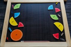 Colorful math fractions and apples as a sample on brown wooden background or table. interesting math for kids. Education, royalty free stock photography